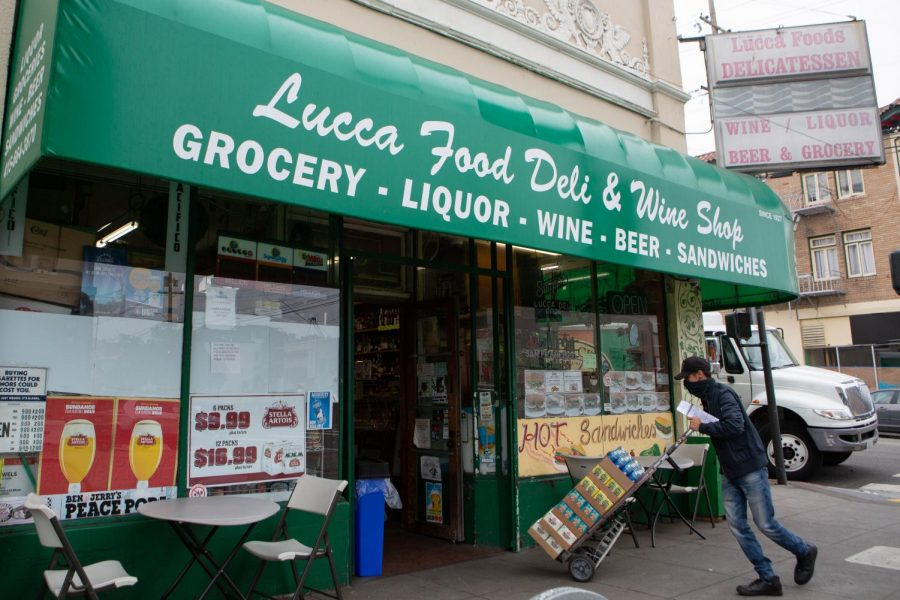 A vendor delivers products to Lucca Food Deli & Wine Shop in San Francisco on Aug. 30, 2020. (Sean Reyes / Golden Gate Xpress)