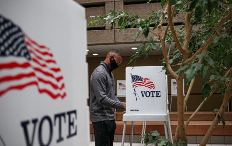 Logan Carrington casts his vote at the Santa Clara County Registrar of Voters in San Jose, Calif., on Oct. 7, 2020. The former Virginian says,