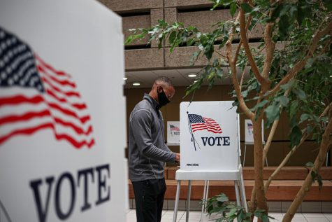 "Logan Carrington casts his vote at the Santa Clara County Registrar of Voters in San Jose, Calif., on Oct. 7, 2020. The former Virginian says, ""I want to control the narrative of my vote,"" explaining why he chose to vote in person and not mail in his ballot.  (Harika Maddala / Xpress Media)"