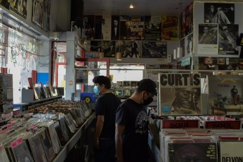 Shoppers browse wide music selections at Amoeba Music, a local record store in Berkeley CA, after they reopen their doors on Oct. 16, since the COVID-10 closures in March. (Leila Figueroa / Golden Gate Xpress)