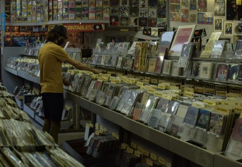 Shoppers browse wide music selections at Amoeba Music, a local record store in Berkeley Calif., after they reopen their doors on Oct.16, since the COVID-19 closures in March. (Leila Figueroa / Golden Gate Xpress)