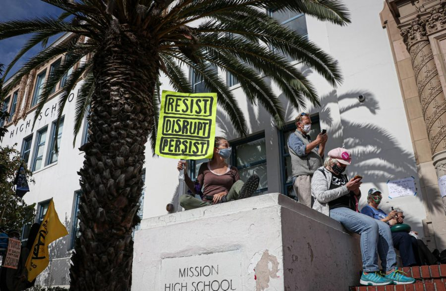 Ruthie Sakheim, of Occupy San Francisco, holds a sign that says, 'Resist, Disrupt, Persist' at the 'March for democracy event' outside Mission High School in San Francisco on Oct. 24, 2020. (Harika Maddala / Golden Gate Xpress)