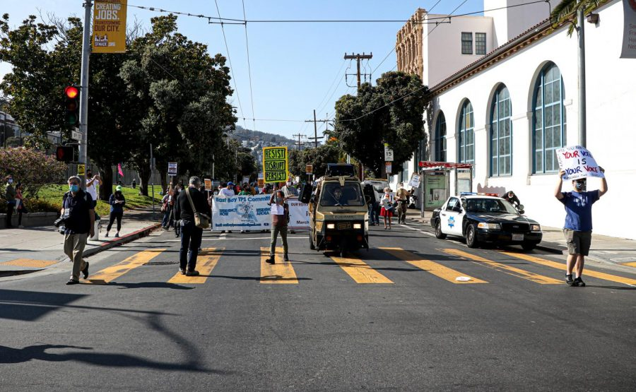 Protesters march towards Valencia St. while chanting slogans such as