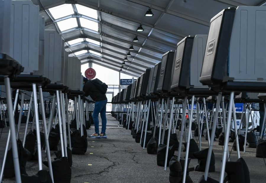 A San Francisco resident votes at the in-person Voting Center located in front of the Bill Graham Civic Auditorium in San Francisco on Oct. 7, 2020. (James Wyatt / Golden Gate Xpress)