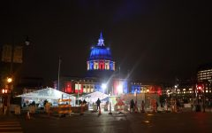 The Voting Center located in front of the Bill Graham Civic Auditorium with San Francisco City Hall in the background lit up with red, white and blue lights in San Francisco on Nov. 3, 2020. (Dyanna Calvario / Golden Gate Xpress)