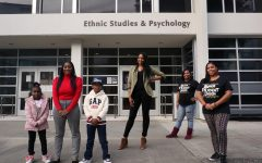 Shanice Robinson, her niece and son, Tiffany Knuckles, Tachelle Herron Lane, and Danielle Tompkins, who organized Soul of SF to channel the voices and experiences of Black students, staff and community members of SF, stand in front of the Ethnic Studies and Psychology building at SF State in San Francisco, on Nov. 21, 2020. (Alex Drew / Golden Gate Xpress)