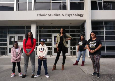 Shanice Robinson, her niece and son, Tiffany Knuckles, Tachelle, and Danielle Knuckles, who organized Soul of SF to channel the voices and experiences of Black students, staff and community members of SF, stand in front of the Ethnic Studies and Psychology building at SF State in San Francisco, on Nov. 21, 2020. (Alex Drew / Golden Gate Xpress)