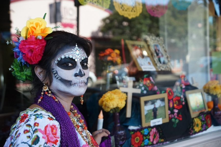Lin-Yu Diaz stands next to the altar she set up for Día de Los Muertos, near 4th St. in San Rafael, Calif., on Friday, Oct. 30, 2020. (Ricardo Olivares / Golden Gate Xpress)