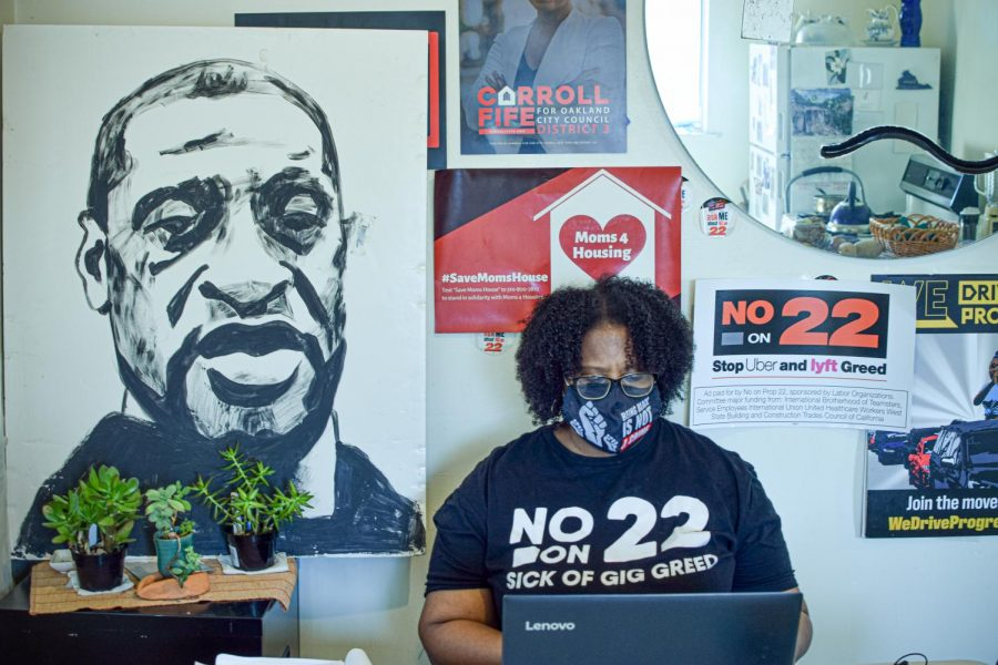 Uber driver and prop 22 advocate Cherri Murphy works at her home office in her apartment in Oakland, Calif., on Dec. 4, 2020. (Leila Figueroa / Golden Gate Xpress)