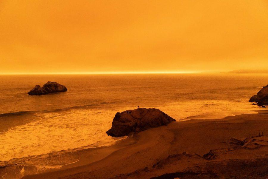 A orange haze covers Ocean Beach in San Francisco due to ash and residue from the California wildfires. (Saylor Nedelman / Golden Gate Xpress)
