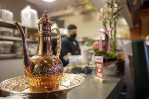 A copper tea kettle sits on a copper tray at the front desk register at Abu Salim Middle Eastern Grill on Haight Street in San Francisco, on Nov. 7, 2020. (Emily Curiel / Golden Gate Xpress)