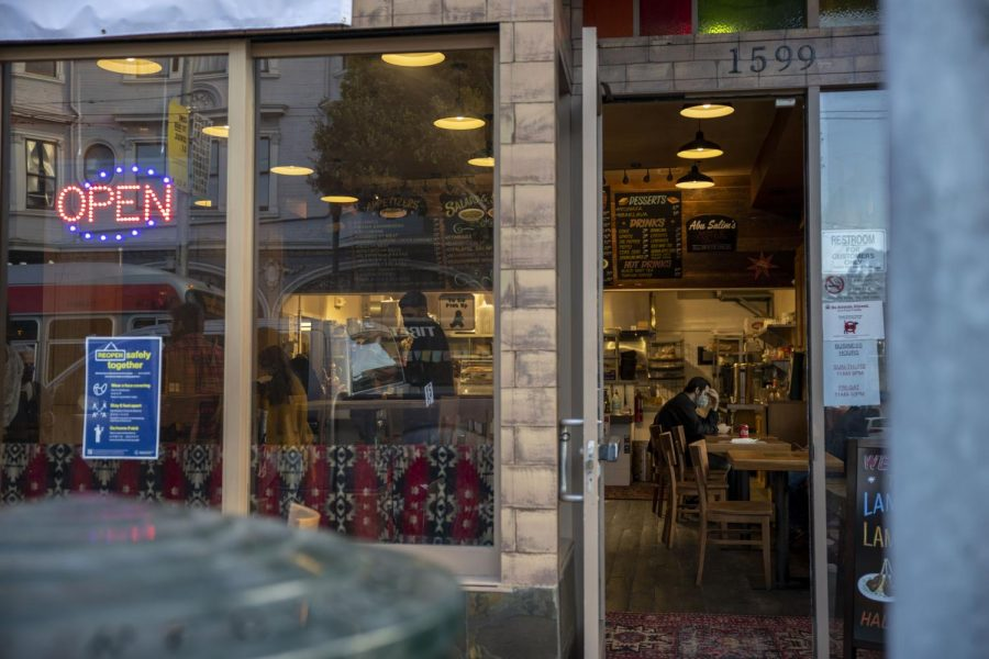 A costumer dines alone at Abu Salim Middle Eastern Grill on Haight Street in San Francisco, on Nov. 7, 2020. (Emily Curiel / Golden Gate Xpress)