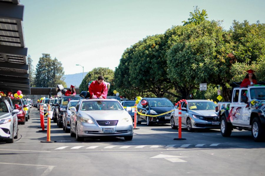 Students wait in their cars for the commencement of the graduation car parade at Cupertino High School, in Cupertino, Calif., on June 4, 2020. (Harika Maddala / Golden Gate Xpress)