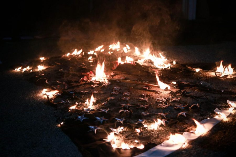 An American flag burns outside the home of Walnut Creek's Mayor, in Walnut Creek, Calif. on June 17, 2020. (Harika Maddala / Golden Gate Xpress)