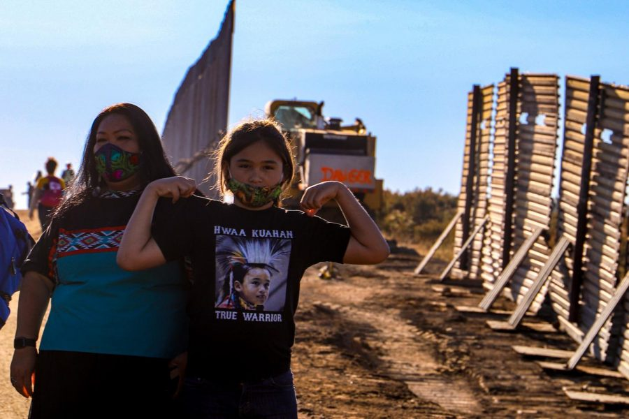Hwaa Kuahan, 10, begs his mother, Martha Rodriguez, every day to join in protesting the border wall. Rodriguez is one of the protest leaders and a teacher of cultural practices at Kumeyaay community college. According to Rodriguez, she allows him to join when there will not be dynamite involved in the construction process and she deems the day's activities as safe. His name translates to 'True Warrior.'(Camille Cohen / Golden Gate Xpress)