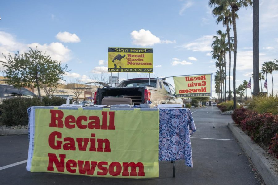 "A ""Recall Gavin"" petition signing location set up in the parking lot of Walmart in Sacramento. The petition organizers say they have enough signatures to warrant a ballot measure. (Ellie Doyen / Golden Gate Xpress)"