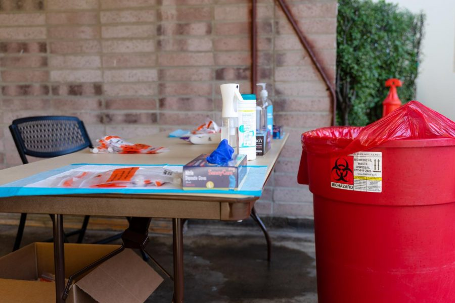 Unused nasal swab testing kits for COVID-19 lay organized on the table at the University Park North testing site on Friday. Testing staff expected 100 students, but only around 50 students dropped by to this location. (Jun Ueda / Golden Gate Xpress)
