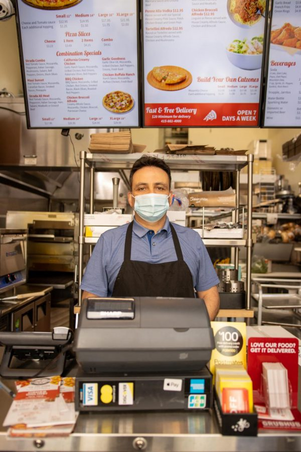 Kevin Razi, co-owner of Strada Pizza, gets ready to open its door at 4 p.m in the Sunset district on February 2, 2020. (Amalia Diaz / Golden Gate Xpress)