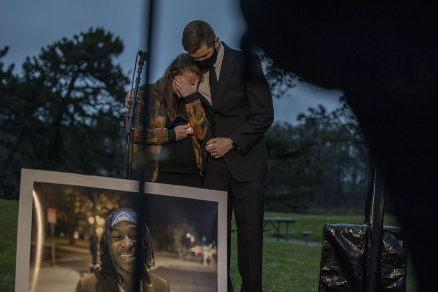 Michah Ege embraces his sister at Sheria Musyoka's community vigil in Harding Park on Thursday, Feb. 11, 2021. (Emily Curiel / Golden Gate Xpress)