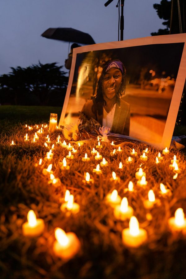 A portrait of Sheria Musyoka lit by candles at the community vigil held in Harding Park on Thursday. (Jun Ueda / Golden Gate Xpress)