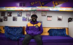 Jason Phillips, SF State alum and vice president of Omega Psi Phi Fraternity Inc., Pi Chi Chapter, sits in a space for youth where he works at 100% College Prep. (Lucky Whitburn-Thomas / Golden Gate Xpress)