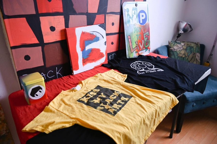 Art pieces and shirts in front of a window in the KMBA studio on Feb. 19. (Samantha Laurey / Golden Gate Xpress)