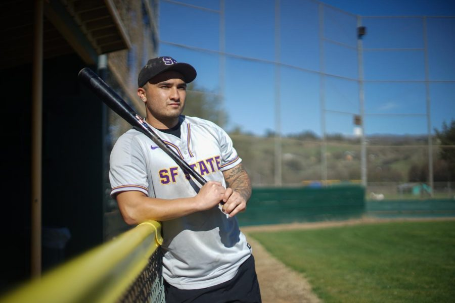 Richie Rios, a 23-year-old student athlete from Gilroy, leans on the team fence at a baseball field at Morgan hill on Feb 21. Rios made the 2020 All Stars honorable mention from the California Collegiate Athletic Association. (Ricardo Olivares / Golden Gate Xpress)