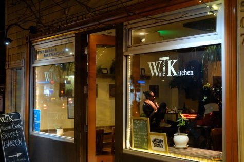Two customers dine inside Wine Kitchen on Divisadero Street in San Francisco on March 3. The city of San Francisco moved into red tier, allowing gyms, museums, and indoor dining operations in limited capacity. (Avery Wilcox / Golden Gate Xpress)