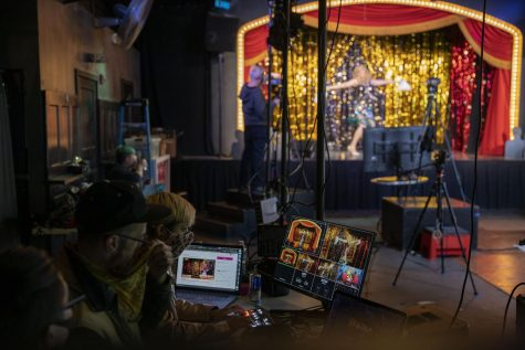 Producers sit behind a desk as they monitor the show for online viewers. Oasis produced a telethon on Saturday March 6, 2021 from 12PM –12AM to help the club from closing down. (Emily Curiel / Golden Gate Xpress)