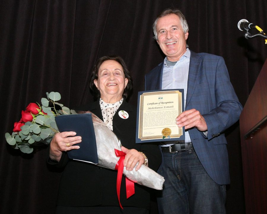 Merhbanoo receiving a certificate of recognition from former Corte Madera Mayor Bob Ravasio for her educational and social efforts in Marin County. (Courtesy of Esmaili family)