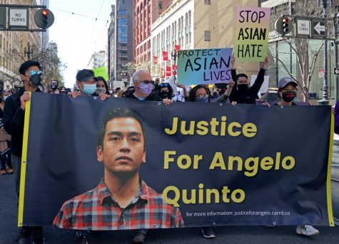 Demonstrators, holding a banner for Angelo Quinto, march toward Embarcadero Plaza from Union Square. Quinto was a Filipino immigrant who died after an interaction with the Antioch police. (Sabita Shrestha / Golden Gate Xpress)
