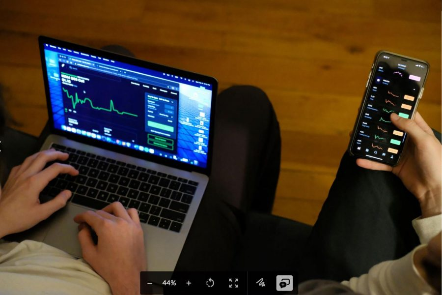 Jack Deremiah (left) and Charles Evers (right), SF State students, monitor stocks on the free trading app, Robinhood, in their home in San Francisco on February 6, 2021. (Avery Wilcox / Golden Gate Xpress)