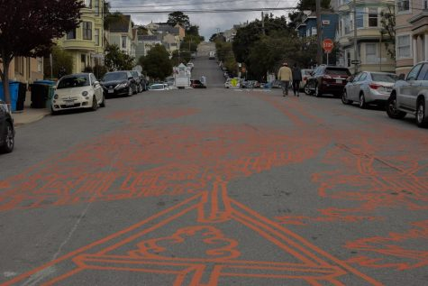 "Pedestrians walk alongside Amos Goldbaum's recently completed mural, in the heart of Noe Valley. Goldbaum said, ""Now it feels like a cohesive whole."" (Leila Figueroa / Golden Gate Xpress)"