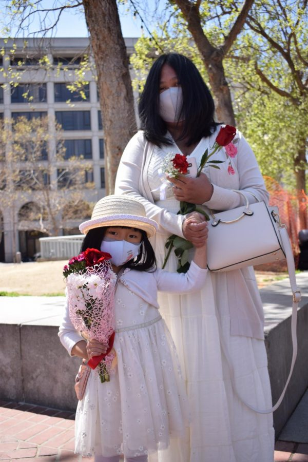 Free Burma Action Committee organizer and UC Berkeley political science student, Khin T. Soe, and her daughter at the Flower Strike in the UN Plaza/Civic Center on Saturday, April 10, 2021. (Lucky Whitburn-Thomas / Golden Gate Xpress)