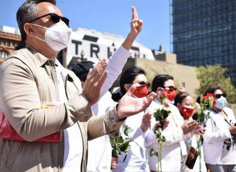 Attendants at the Flower Strike at the United Nations Plaza/Civic Center on Saturday, April 10, 2021. The strike commemorated those who had died in the anti-coup protests. (Lucky Whitburn-Thomas / Golden Gate Xpress)