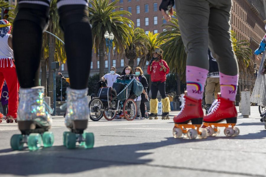 Owner of Church of 8 Wheels, Rev. David Miles Jr., speaks to a crowd of skaters in front of the Ferry building on March 27, 2021. Miles held a skating demonstration called 'Skate Against Violence' to showcase solidarity for the Asian community. (Emily Curiel / Golden Gate Xpress)