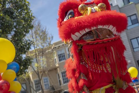 Yau Kung Moon lion dance crew performs for a crowd of people who gathered at the Asian Community Support Event on Sunday, April 11, 2021, at 701 Valencia St., in the Mission District. (Emily Curiel / Golden Gate Xpress)