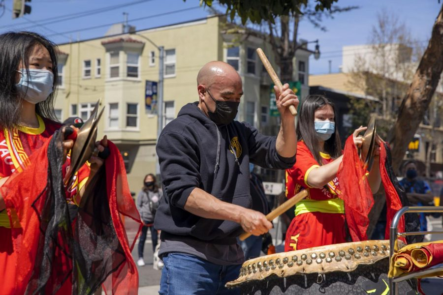 Park Jung plays the tanggu as the Yau Kung Moon lion dance crew performs for a crowd of people who gathered at the Asian Community Support Event on Sunday, April 11, 2021, at 701 Valencia St., in the Mission District. (Emily Curiel / Golden Gate Xpress)