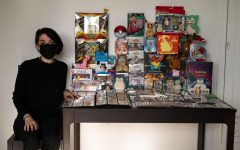 Micky Gallegos, 25, U.C. Berkeley music graduate, shows off her collection of Pokemon cards and items that have been collected over a span of six years in her apartment in Berkeley, Calif., on April 16. She states that looking for the most valuable items is not what makes collecting fun, it's finding what she likes and wants for the collection. (Samantha Laurey / Golden Gate Xpress)