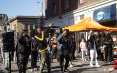 Local rappers Footz (Left) and Marlee Boy (Right) enjoying themselves while performing for audience members at 415 Day Fest on Larkin Street. (Dan DeJesus / Golden Gate Xpress)