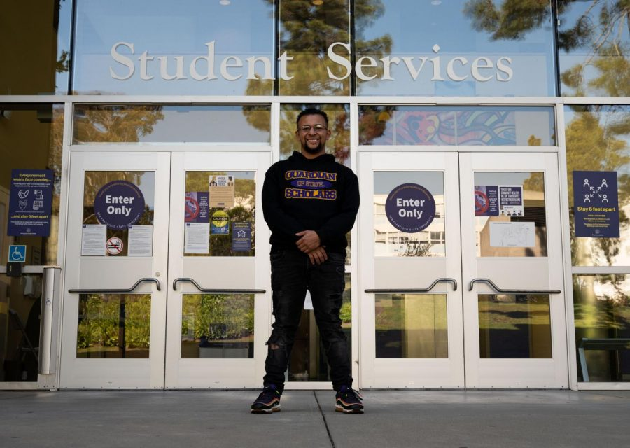 Joel Jerimiah Martin-Dill stands in front of the Student Services Building at SF State as the program's office is located on the third floor of the building on May 4, 2021. Martin-Dill states that the program provides resources for foster care students such as mental health services, housing and funding for college. (Samantha Laurey / Golden Gate Xpress)