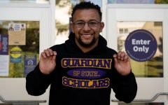 Joel Jerimiah Martin-Dill shows off his Guardian Scholars sweatshirt in front of the Student Services Building at SF State on May 4, 2021. The Guardian Scholars program was launched in 2005 to help any current or former foster care youth with their college experience. (Samantha Laurey / Golden Gate Xpress)