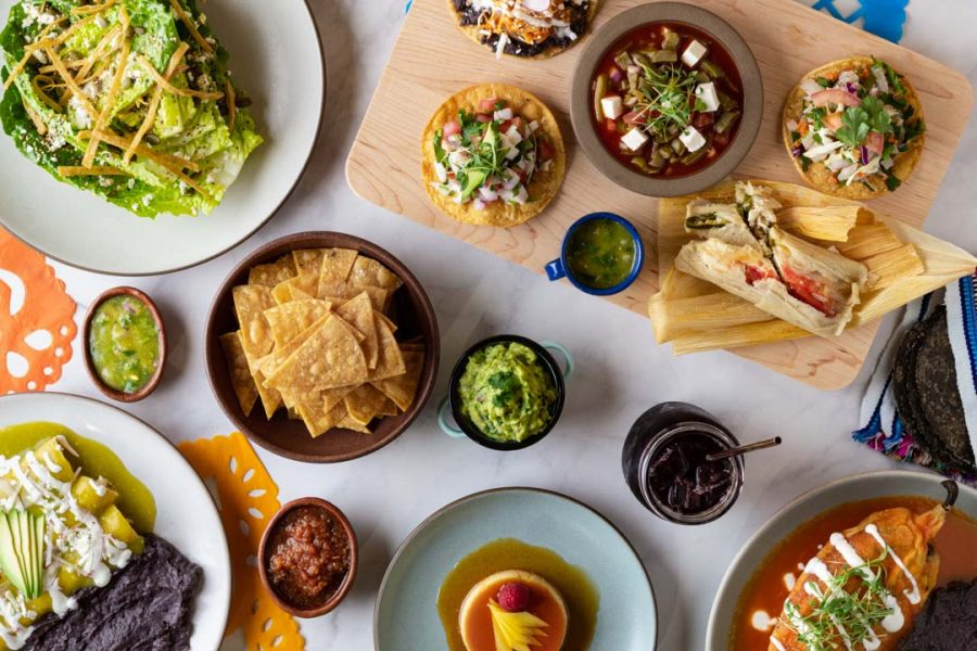 An assortment of dishes from Los Cilantros and other restaurants in the marketplace, which includes Creole, Salvadorian, Algerian, Mexican and Senegalese cuisine. (Courtesy of Allie Finnegan / La Cocina Marketplace)