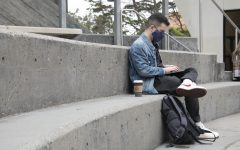 Chris Harris, a graduate student in SF State's BECA department, works in the common area outside of the Cesar Chavez Student Center on Aug. 24, 2021. Harris mentioned the benefits of being back on campus as opposed to stuck on Zoom, despite adjustments such as no longer being able to sip on a coffee during class. (Morgan Ellis / Golden Gate Xpress)