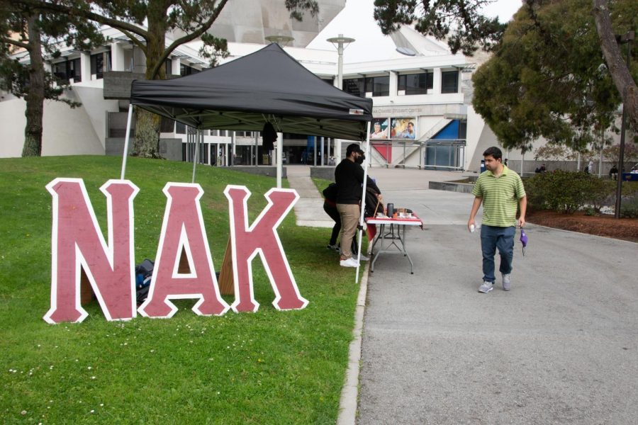Representatives from SF State's Nu Alpha Kappa fraternity set up in the Cesar Chavez Student Center to encourage enrollment on Sept. 9, 2021. Greek organizations have had to adjust to keep up with the obstacles of distance learning and a sparse return to campus. (Morgan Ellis/Golden Gate Xpress)