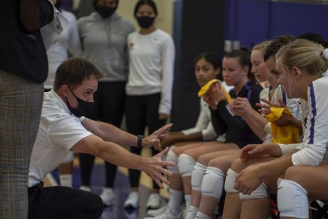 SF State women's volleyball head coach Matt Hoffman coaches his starters during a timeout against Northwest Nazarene in the Main Gym at Don Nasser Family Plaza on Friday, Sep. 3, 2021. (Nicolas Cholula/Golden Gate Xpress)