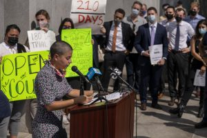 """Jade Arellano speaks during a rally outside the San Francisco Hall of Justice on Sep. 21, 2021. Arellano is the organizing director with the Western Regional Advocacy Group, which claims on their website to """"expose and eliminate the root causes of civil and human rights abuses."""" (Nicolas Cholula/Golden Gate Xpress)"""