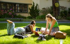 Esperanza and Rose (L to R) spend time in the sun doing homework in San Francisco State University's Garden of Remembrance on Sept. 20, 2021. (Garrett Isley/Golden Gate Xpress)