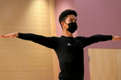 Lam Nguyen, 26, practices in Little Theater at SF State on Aug. 31, 2021. Him and his wife, Yasmine Nguyen, had to share their living room for performing, practicing and attending Zoom classes, which wasn't suitable for them. (Sabita Shrestha/Golden Gate Xpress)