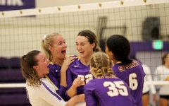 SF State women's volleyball team hugs in a group after winning a point against Cal State LAon Sep. 25, 2021, in the Main Gym at Don Nasser Family Plaza.(Sabita Shrestha/Golden Gate Xpress)